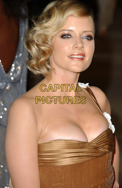 MARLEY SHELTON.The 2007 Vanity Fair Oscar Party Hosted by Graydon Carter held at Morton's, West Hollywood, California, USA, 25 February 2007..oscars half length strapless white flowers gold dress straps.CAP/ADM/GB.©Gary Boas/AdMedia/Capital Pictures.
