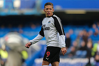 Dwight Gayle of Newcastle United warms up ahead of the Premier League match between Chelsea and Newcastle United at Stamford Bridge, London, England on 2 December 2017. Photo by David Horn.