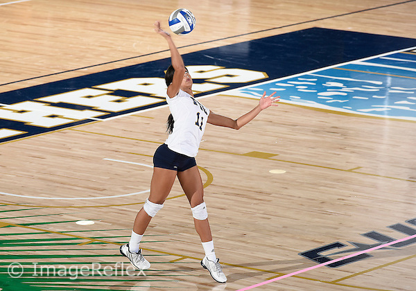 Florida International University women's volleyball setter Kiona McSwain (11) plays against  the University of Central Florida which won the match 3-0 on September 17, 2015 at Miami, Florida.