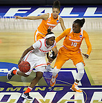 SIOUX FALLS, SD - MARCH 27, 2016 -- Alexis Peterson #1 of Syracuse drives around Tennessee defenders Meme Jackson #10 and Andraya Carter #14 during their NCAA DI Regional Championship game Sunday at the Denny Sanford Premier Center in Sioux Falls, S.D.  Syracuse won 89-67 to advance to the Final Four and will face Washington. (Photo by Dick Carlson/Inertia)