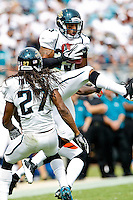 October 09, 2011:   Jacksonville Jaguars strong safety Dwight Lowery (25) leaps up to intercept a pass from Cincinnati Bengals quarterback Andy Dalton (14) (not pictured) during second quarter action between the Jacksonville Jaguars and the Cincinnati Bengals played at EverBank Field in Jacksonville, Florida.  ........