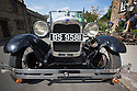 16/08/16<br /> <br /> You'd be forgiven for thinking you'd had one drink too many if you called a cab in this Derbyshire Peak District village, because you'll get a 1929 vintage Model A Ford turn up as it's the only taxi in town!<br /> <br /> Full story here: https://fstoppressblog.wordpress.com/vintage-car-is-the-only-taxi-in-town/<br /> <br /> What's more, it's the oldest vehicle licensed for private hire in the UK, as cars usually have to be less than three years old to get a licence.<br /> <br /> But thanks to a special exemption to get round not having seat belts and the usual modern specifications, this fabulous-looking car is a regular sight pootling around the narrow lanes of the Derbyshire Dales.<br /> <br /> So when Debbie Slater needed a ride home from the Old Bowling Green pub in Winster she knew exactly who to call for an open-top ride in the sunshine.<br /> <br /> <br /> All Rights Reserved, F Stop Press Ltd. +44 (0)1773 550665