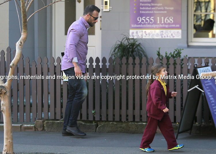 25 JULY 2013 SYDNEY AUSTRALIA<br /> <br /> EXCLUSIVE PICTURES<br /> <br /> Steve 'Commando' Willis pictured with his defacto wife Froso and daughter leaving a therapy session in Balmain<br /> <br /> <br /> *No internet without clearance*.MUST CALL PRIOR TO USE +61 2 9211-1088. Matrix Media Group.Note: All editorial images subject to the following: For editorial use only. Additional clearance required for commercial, wireless, internet or promotional use.Images may not be altered or modified. Matrix Media Group makes no representations or warranties regarding names, trademarks or logos appearing in the images.