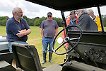 Phil Bashall of the Dunsfold Collection next to his 1942 Willys Jeep which carries the FWD 534 number plate that belonged to the Wilk's brothers Jeep from which the first Land Rover prototype was developed in 1947.  Dunsfold Collection of Land Rovers Open Day 2011, Dunsfold, Surrey, UK. --- No releases available, but releases may not be necessary for certain uses. Automotive trademarks are the property of the trademark holder, authorization may be needed for some uses.