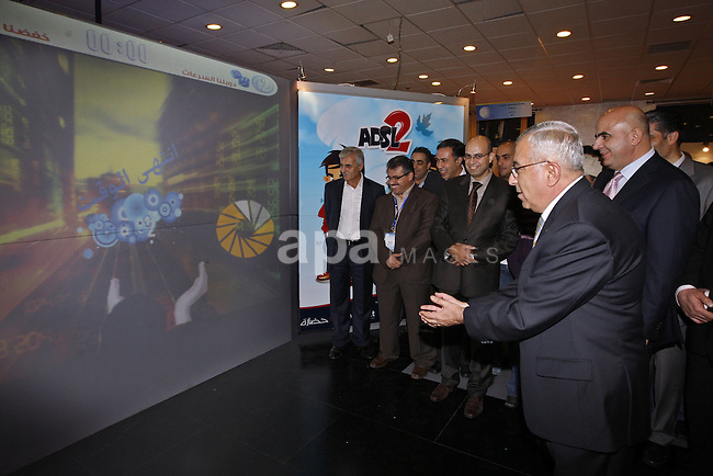 "Palestinian Prime Minister Salam Fayyad during his visit to the first technology ""expoech 2009"" in the West Bank city of Ramallah on Nov 5,2009. Photo by Mustafa Abu Dayeh."
