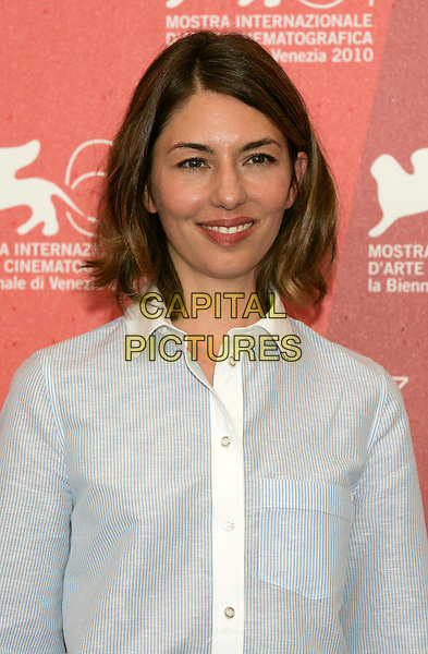 "SOFIA COPPOLA.""Somewhere"" photocall during the .67th Venice International Film Festival,.Venice, Italy, September 3rd, 2010..half length white shirt smiling director blue striped pinstripe .CAP/PE.©Peter Eden/Capital Pictures."