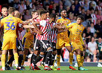 Tempers flare after a challenge from Wigan's Sam Morsy on Yoann Barbet of Brentford during Brentford vs Wigan Athletic, Sky Bet EFL Championship Football at Griffin Park on 15th September 2018