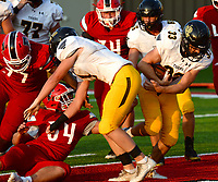 NWA Democrat-Gazette/ANDY SHUPE<br /> Prairie Grove fullback Foster Layman (33) carries the ball into the end zone Friday, Sept. 6, 2019, past Farmington linebacker Hayden Cox (34) during the first half of play at Cardinal Stadium in Farmington. Visit nwadg.com/photos to see more photographs from the game.