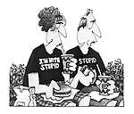 (A couple wearing slogan T shirts. the man reads 'Stupid', the woman's reads 'I'm with Stupid')