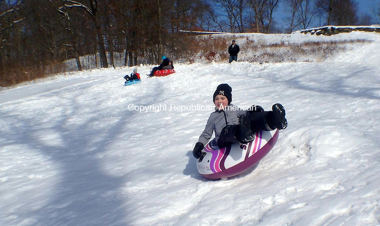 NAUGATUCK, CT - 020914PS02 - Kaleb Bratchell, 5, of Naugatuck, slides over a hump at Hop Brook Golf Course Sunday afternoon. Several people from the area enjoyed near perfect conditions for sledding all day long. Paul Singley Republican-American