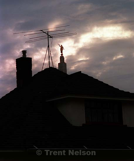 The Angel Moroni peeks out over a home, Idaho Falls, October 1987.  &amp;#xA;<br />