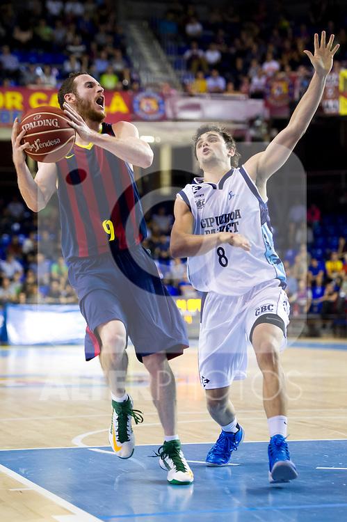 FC Barcelona's Marcelinho Huertas (left) and Gipuzkoa Basket Club's Raul Togni Neto (right) during Liga Endesa ACB 2013-2014 match. November 3, 2013. (ALTERPHOTOS/Alex Caparros)