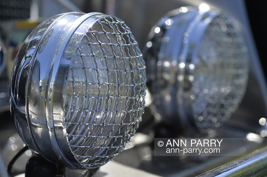 Westbury, New York, USA. June 12, 2016.  Round chrome running lights with wire stone guard protectors, close up of 1973 Intermeccanica Squire SS-100 Italian luxury classic roadster, owned by Mark Offenberg of Valley Stream, which won 3rd Place Trophy in the foreign car category at the Antique and Collectible Auto Show at the 50th Annual Spring Meet at Old Westbury Gardens, in the Gold Coast of Long Island, and sponsored by Greater New York Region, GNYR, Antique Automobile Club of America, AACA. Car is the 46th of only 50 Intermeccanica's coachbuilt in Turin, Italy. Participating vehicles in the judged show included hundreds of domestic and foreign, antique, classic, collectible, and modern cars.