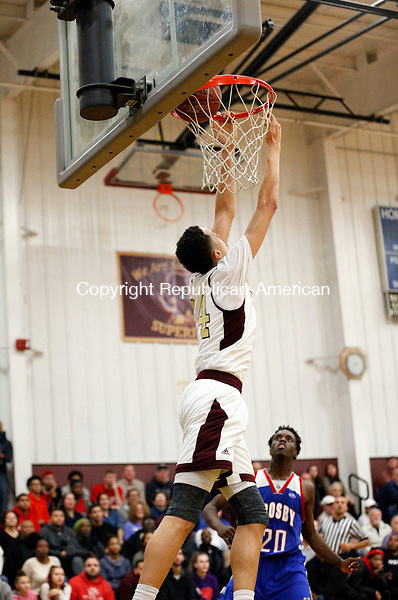 Waterbury, CT- 15 January 2016-011516CM07-  Sacred Heart's Tyrn Flowers dunks the bullhead of Crosby's Dan Jones during their NVL matchup in Waterbury on Friday.  Sacred Heart would go onto win, 96-61.  Christopher Massa Republican-American