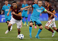 Calcio, Champions League, Gruppo E: Roma vs Barcellona. Roma, stadio Olimpico, 16 settembre 2015.<br /> FC Barcelona's Andres Iniesta, center, is challenged by Roma's Kostas Manolas, left, and Alessandro Florenzi, during a Champions League, Group E football match between Roma and FC Barcelona, at Rome's Olympic stadium, 16 September 2015.<br /> UPDATE IMAGES PRESS/Isabella Bonotto