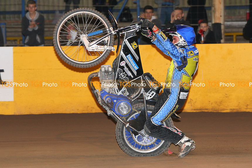 Heat 15: Lewis Bridger does a wheelie to celebrate an Eastbourne victory - Eastbourne Eagles vs Lakeside Hammers - Elite League Speedway Play-Off Semi-Final 2nd Leg at Arlington Stadium - 26/09/11 - MANDATORY CREDIT: Gavin Ellis/TGSPHOTO - Self billing applies where appropriate - 0845 094 6026 - contact@tgsphoto.co.uk - NO UNPAID USE.