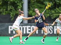 College Park, MD - May 19, 2018: Navy Kayla Harris (25) attempts a shot during the quarterfinal game between Navy and Maryland at  Field Hockey and Lacrosse Complex in College Park, MD.  (Photo by Elliott Brown/Media Images International)