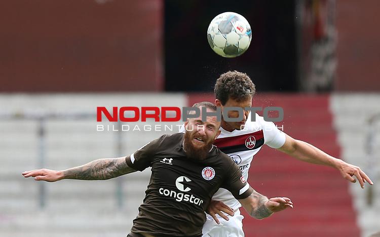 nph0001:  17.05.2020 --- Fussball --- Saison 2019 2020 --- 2. Fussball - Bundesliga --- 26. Spieltag: FC Sankt Pauli - 1. FC Nürnberg ---  DFL regulations prohibit any use of photographs as image sequences and/or quasi-video - Only for editorial use ! --- <br /> <br /> Marvin Knoll (5, FC St. Pauli ) Georg Margreitter (33, 1. FC Nürnberg ) <br /> Foto: Daniel Marr/Zink/Pool//via Kokenge/nordphoto