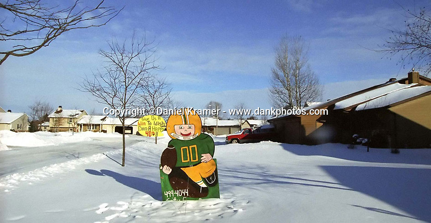 The city of Green Bay has a population of about 100,000 and signs of the town's love for the Packers are everywhere.
