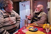 Alexander Demidov, 61, sits with his friend, writer Stanislav Konstatinov 65, Chernobyl explosion in 1986. They were part of  a massive team of &quot;liquidators&quot; responsible for the clean up of the nuclear fallout in the months and years that followed. <br /> <br /> They have been living in Slavutych for the last decades. Demidov is suffering from multiple health problems in his lungs and joints, while Konstantinov is healthy. <br /> <br /> Slavutych rises out of the ashes of the Chernobyl nuclear disaster in April 26, 1986. People living near the disaster area were largely moved to the new city, built from scratch for the sole purpose of housing the population displaced by the nuclear accident.