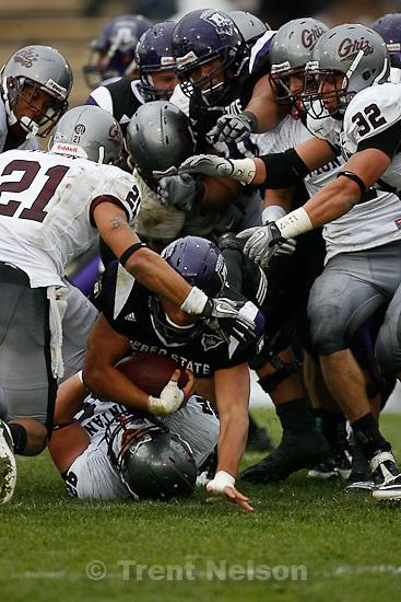 Trent Nelson  |  The Salt Lake Tribune.Weber State's Vaingamalie Tafuna runs the ball during the second half, Weber State vs. Montana, college football Saturday, October 30, 2010.