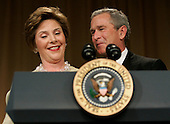 United States President George W. Bush looks admiringly at First Lady Laura Bush as she steals the show by taking over the President's speech during the annual White House Correspondents' Association dinner at the Washington Hilton in Washington, D.C., 30 April 2005. The annual dinner began in 1914 as a bridge between the White House and its media corps and tonight feautured a mix of political insiders including Supreme Court Justices, Antonin Scalia and Stephen Breyer, and Hollywood elite such as Goldie Hawn and Richard Gere.<br /> Credit: Katie Falkenberg - Pool via CNP