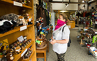 Nichole Wright of Aurora, Colo. peruses the gift shop Saturday, May 16, 2020, in the visitor center at Hobbs State Park - Conservation Area near Rogers. Go to nwaonline.com/200517Daily/ to see more photos.<br /> (NWA Democrat-Gazette/Ben Goff)