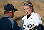 March 23, 2012:   Nevada Wolf Pack head coach Matt Meuchel talks to pitcher Mallary Darby during their game against the  Fresno State Bulldogs during their NCAA softball game played at Christina M. Hixson Softball Park on Friday in Reno, Nevada.