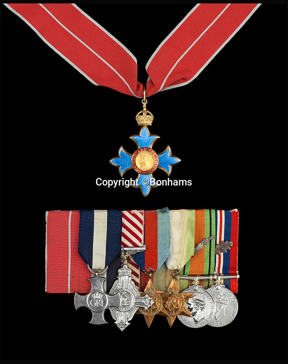 BNPS.co.uk (01202 558833)<br /> Pic: Bonhams/BNPS<br /> <br /> The Most Excellent Order of the British Empire, C.B.E (top), (L to R) Commander's neck badge, 2nd type, Military Division, in silver-gilt and enamel; Distinguished Service Cross; Air Force Cross; 1939-1945 Star; Atlantic Star; Defence Medal with King's Commendation for Brave Conduct and War Medal.<br /> <br /> The historic medals and logbooks of legendary test pilot Eric 'Winkle' Brown have been saved for the nation and will be displayed in a British museum.<br /> <br /> A deal has been secured for the hero's prestigious decorations and all his flying journals after they failed to sell at auction earlier this week.<br /> <br /> They had been expected to sell for &pound;200,000, possibly to an overseas buyer, but bidding only reached &pound;140,000, falling short of the reserve price.<br /> <br /> Now it has emerged that the National Museum of the Royal Navy has negotiated a deal with Captain Brown's family to buy his stunning archive.