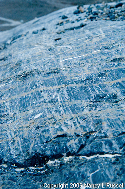 The scratches on this rock was created by the glacier scraping against the rock as it moved
