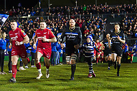 Matt Garvey of Bath Rugby, mascot in hand, leads his team out onto the field. European Rugby Champions Cup match, between Bath Rugby and the Scarlets on January 12, 2018 at the Recreation Ground in Bath, England. Photo by: Patrick Khachfe / Onside Images