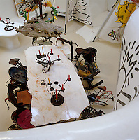 The interior of Niki de Saint Phalle's sculptural house is furnished with a set of chairs by Jean Tinguely and a collection of modern art