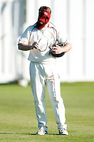 A North Middx player rearranges his equipment during the Middlesex County Cricket League Division Two game between North Middlesex and Enfield at Park Road, Crouch End, London on Sat May 22, 2010