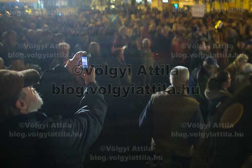 Protester takes a photo with his mobile phone during a demonstration against government corruption in Budapest, Hungary on November 08, 2014. ATTILA VOLGYI