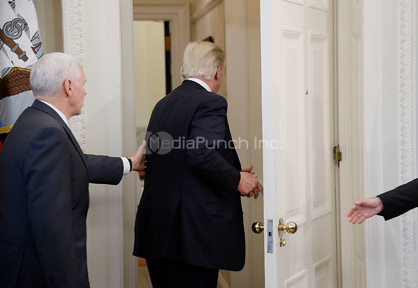 United States President Donald Trump leaves the Oval Office after speaking about trade at the White House March 31, 2017 in Washington, DC. <br /> Credit: Olivier Douliery / Pool via CNP /MediaPunch