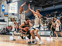 WASHINGTON, DC - JANUARY 29: Chase Paar #3 and Amir Harris #22 of George Washington cover Jin Axel Gudmundsson #3 of Davidson during a game between Davidson and George Wshington at Charles E Smith Center on January 29, 2020 in Washington, DC.