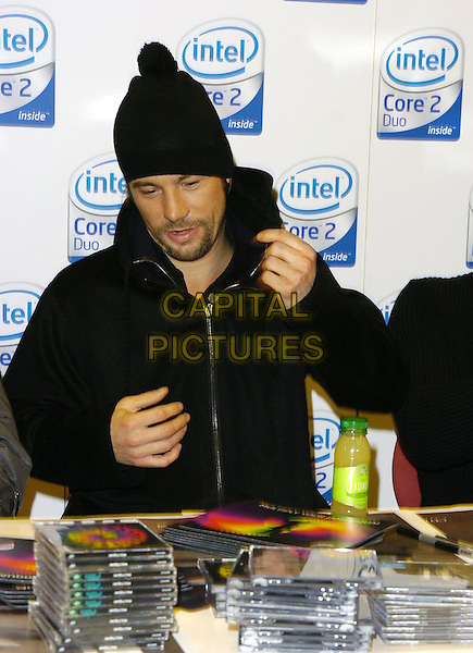 JAY KAY.At the Jamiroquai album Launch & CD Signing, PC World,.Tottenham Court Road, London, England,.November 18th 2006..half length music band group hat.CAP/CAN.©Can Nguyen/Capital Pictures