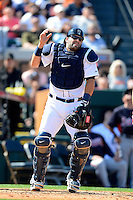 Detroit Tigers catcher Alex Avila #13 looks for the ball on a play during a Spring Training game against the Atlanta Braves at Joker Marchant Stadium on February 27, 2013 in Lakeland, Florida.  Atlanta defeated Detroit 5-3.  (Mike Janes/Four Seam Images)