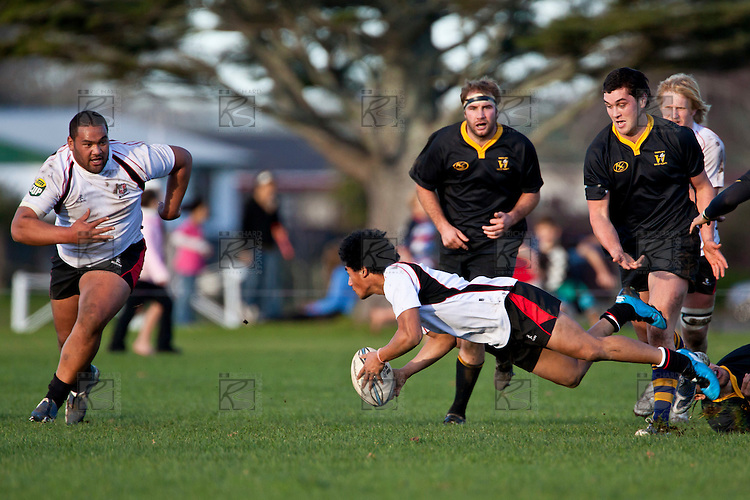 Richie Ah Chong looks to get the pass away to Uini Antonio as he goes to ground. Counties Manukau Steelers pre season ITM Cup game against a Bay of Plenty Wasps selection, played at Moore Park Katikati, on July 7th 2010.