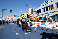 Jodi Bailey and team leave the ceremonial start line with an Iditarider and handler at 4th Avenue and D street in downtown Anchorage, Alaska on Saturday March 4th during the 2017 Iditarod race. Photo © 2017 by Brendan Smith/SchultzPhoto.com.