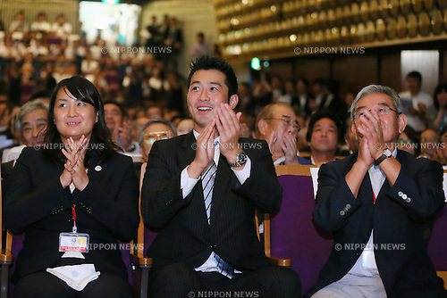 (L to R) Ai Shibata, Junichi Miyashita, Takuji Hayata, SEPTEMBER 8, 2013 : Supporters of Tokyo bid team celebrate after first vote for the Summer Olympic Games in 2020 during the Public Viewing for 2020 Summer Olympic and Games at The Tokyo Chamber of Commerce and Industry hall (Tosho Hall), Tokyo Japan on Sunday September 8, 2013. (Photo by Yusuke Nakanishi/AFLO SPORT) [1090]