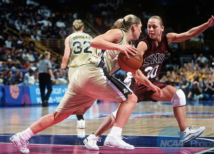 30 MAR 2001:  Guard Kelly Komara (3) of Purdue is guarded closely by guard Melody Campbell (30) of  Southwest Missouri State University during the Division 1 Women's Basketball Semifinals held at the Savvis Center in St. Louis, MO.  Purdue defeated Southwest Missouri State 81-64 to advance to the national championship game.  Jamie Schwaberow/NCAA Photos