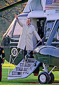 United States President George H.W. Bush waves from the top step of Marine 1 as he prepares to depart the South Lawn of the White House in Washington, D.C. on October 23, 1992..Credit: Ron Sachs / CNP