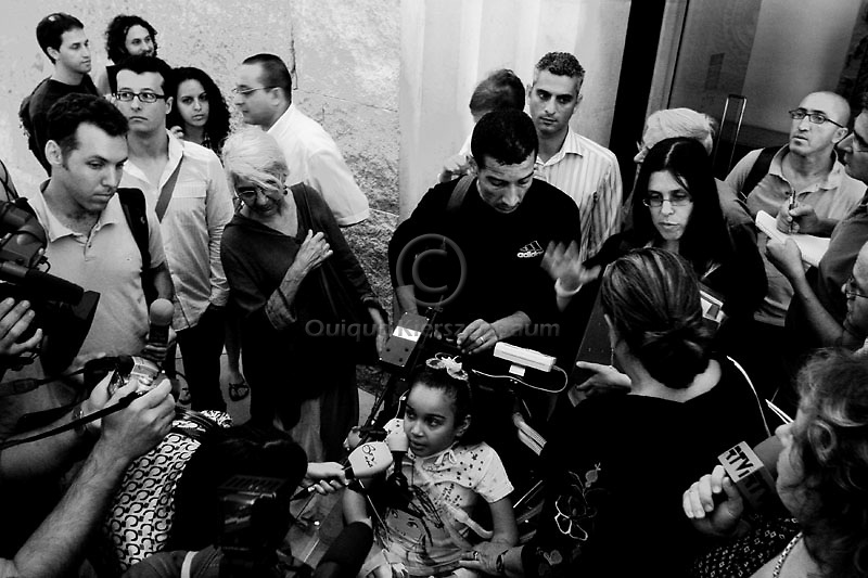 Maryia Aman, a six-year-old Palestinian paralyzed from the neck down when the car she was traveling in was caught in a missile attack on a leader of the Islamic Jihad militant group in Gaza, is accompanied by her father Hamdi  to a hearing at Israel's Supreme Court in Jerusalem July 8, 2008. Amin is fighting an order to move her from a rehabilitation centre in Israel to the occupied West Bank.The Defence Ministry, which has covered Maria's medical expenses and sponsored her father and younger brother to live with her at a Jerusalem hospital, has been seeking since last year to send her to Ramallah's Abu Raya Rehabilitation Centre.