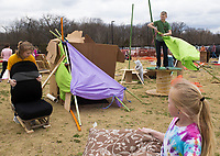 NWA Democrat-Gazette/CHARLIE KAIJO Children build a fort from found materials, Monday, March 19, 2018 at the Amazeum in Bentonville. <br /><br />The adventure playground or &quot;junk playground&quot; allows kids to create their own play space from found materials. The idea is based on a theory of play in existence in Europe since after World War II. People noticed children were playing more in spaces that were bombed out and had loose parts they could interact with rather than the adult designed playgrounds said Jess Graff of Portland, Ore. who brought the idea to Amazeum.<br /><br />&quot;Kids can build a lot of different skills, independence, confidence, teamwork,&quot; Graff said. &quot;As adults we can remember a time as a child we were having a fantastic time. Often those are experiences where there&Otilde;s a little bit of risk involved in the play.&quot;