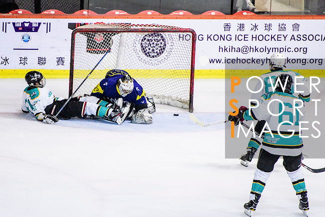 Verity Team Goalie #33 Sam Wong (r) makes a save on Medical Kings Forward #81 Keith Tsang (l) during the Principal Standard League match between Medical Winner Kings vs Verity at the Mega Ice on 17 January 2017 in Hong Kong, China. Photo by Marcio Rodrigo Machado / Power Sport Images