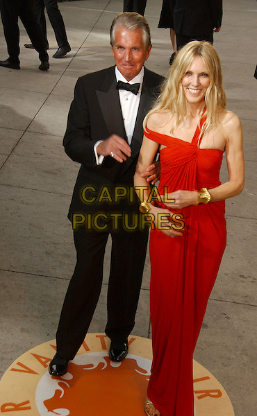 GEORGE HAMILTON & ALANA STEWART.The 2007 Vanity Fair Oscar Party Hosted by Graydon Carter held at Morton's, West Hollywood, California, USA,.25 February 2007..full length red dress.CAP/ADM/GB.©Gary Boas/AdMedia/Capital Pictures.