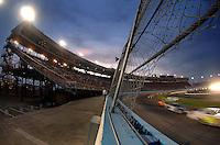 Apr 20, 2007; Avondale, AZ, USA; Nascar Busch Series drivers race through turn two during the Bashas Supermarkets 200 at Phoenix International Raceway. Mandatory Credit: Mark J. Rebilas