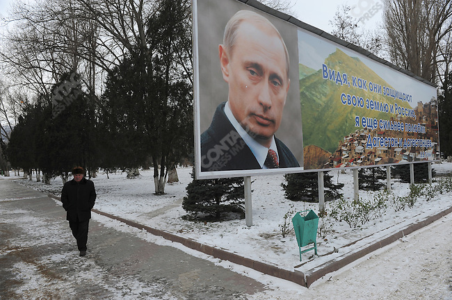 A man walked past a poster on the main square of Mahachkala, the capital of Dagestan, with the portrait and words of the Russian prime minister Vladimir Putin. January 27, 2010