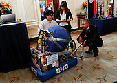 United States President Barack Obama looks at the invention of Sergio Corral and Isela Martinez from Phoenix, Arizona, leaders of the robotics program from Carl Hayden High School during the 2015 White House Science Fair, a celebration of students winners of STEM (Science, technology, engineering and math) competitions from across the country on March 23, 2015,  at the White House in Washington, DC. <br /> Credit: Aude Guerrucci / Pool via CNP